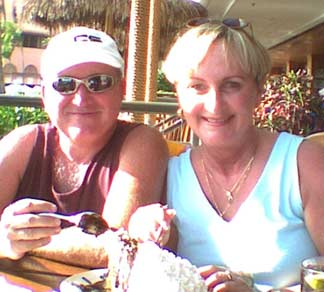 Dennis and wife, Mary, having a decadent dessert at Dukes Bar, Honolulu, Hawaii, December, 2001